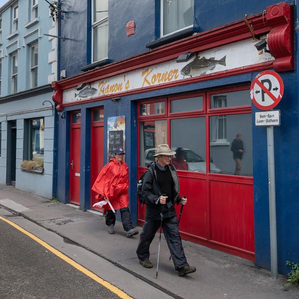Tourists walking on sidewalk, Dingle, County Kerry, Republic of Ireland