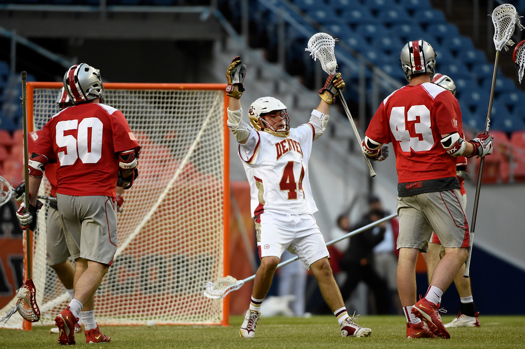 . Sean Cannizzaro (44) of the Denver Pioneers reacts to his goal agains the Ohio State Buckeyes during the second half of Denver\'s 15-13 NCAA tournament quarterfinal win. The Denver Pioneers played the Ohio State Buckeyes at Sports Authority field at Mile High on Saturday, May 16, 2015. (Photo by AAron Ontiveroz/The Denver Post)