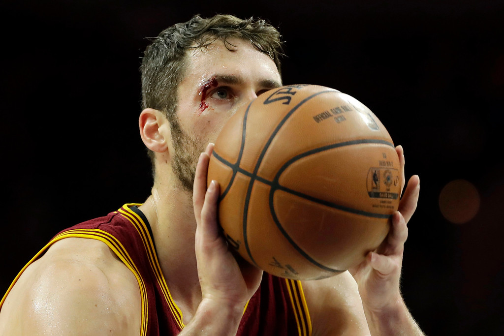 . Cleveland Cavaliers\' Kevin Love takes a free-throw after being injured on a foul by Philadelphia 76ers\' Robert Covington during the first half of an NBA basketball game, Sunday, Nov. 27, 2016, in Philadelphia. (AP Photo/Matt Slocum)