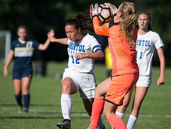 09/17/19 Wesley Bunnell | StaffrrBristol Eastern vs Newington soccer on Tuesday afternoon at Newington High School. Bristol Eastern's Leah Policarpio (12) and Newington's goal keeper Ella DePase (1).