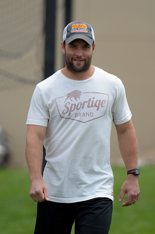 . Denver Broncos WR Wes Welker heads to the tent to meet with the media as players report to camp July 24, 2013 at Dove Valley. (Photo By John Leyba/The Denver Post)