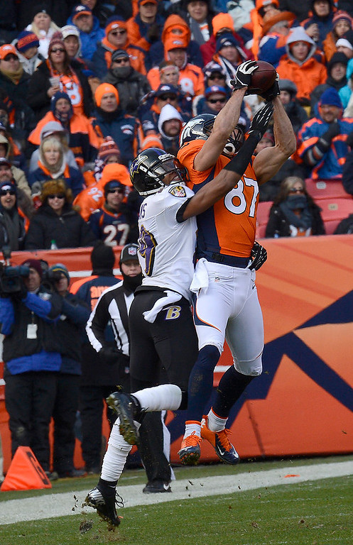 . Denver Broncos wide receiver Eric Decker (87) catches a pass for a gain in the first quarter. The Denver Broncos vs Baltimore Ravens AFC Divisional playoff game at Sports Authority Field Saturday January 12, 2013. (Photo by Joe Amon,/The Denver Post)