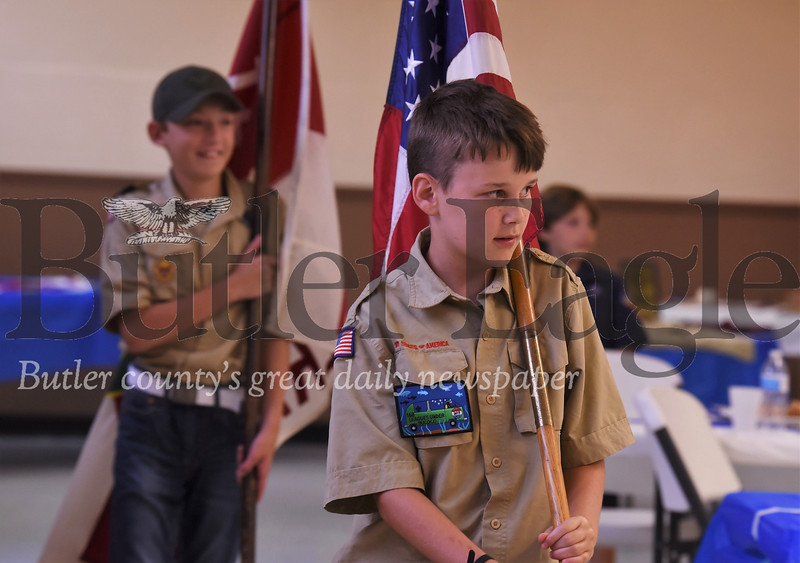 Kaden Crocker, 10, and Kaden Solup, 12, carry flags to take down colors at the end of Boy Scout Troop 19's 100th anniversary festivities. Seb Foltz/Butler Eagle