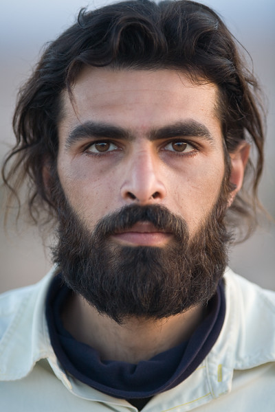 Garmeh, Iran - February, 2008: Pouya Danesh, portrait of a young Iranian man in the desert oasis of Garmeh. (Photo by Christopher Herwig)