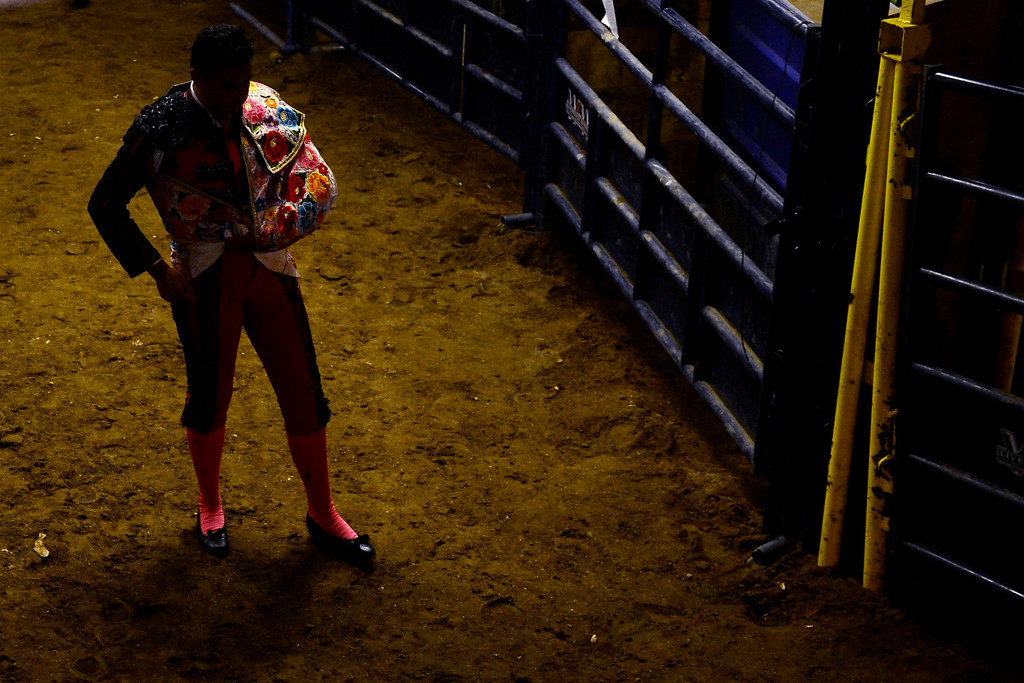 . Matador Paco Munoz prepares to take the arena during National Western Stock Show\'s Mexican Rodeo Extravaganza at the Denver Coliseum on Sunday, Jan. 13, 2013. AAron Ontiveroz, The Denver Post