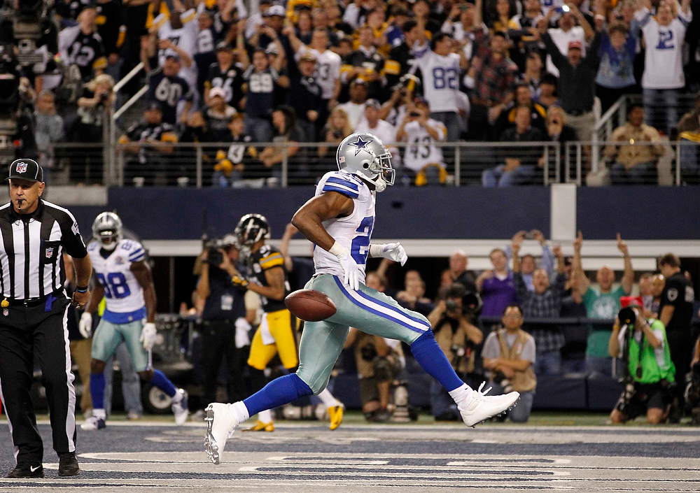 Description of . Dallas Cowboys running back DeMarco Murray runs through the end zone after scoring a touchdown against the Pittsburgh Steelers in the second half of their NFL football game in Arlington, Texas December 16, 2012. REUTERS/Mike Stone