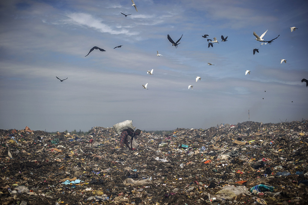 . A rubbish picker sifts through garbage at the Maputo municipal garbage dumping site in Maputo on October 14, 2014.  GIANLUIGI GUERCIA/AFP/Getty Images