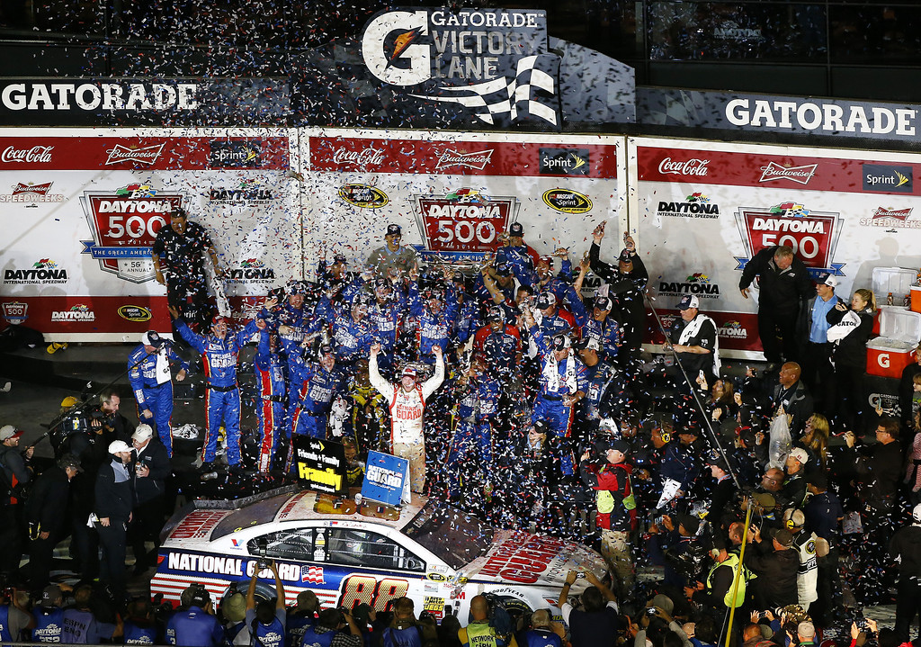 . Dale Earnhardt Jr., driver of the #88 National Guard Chevrolet, celebrates in Victory Lane after winning during the NASCAR Sprint Cup Series Daytona 500 at Daytona International Speedway on February 23, 2014 in Daytona Beach, Florida.  (Photo by Brian Lawdermilk/Getty Images)
