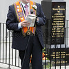 The 12th July L.O.L. parade in Bessbrook. Bro. George McKelvey, District Treasurer, L.O.L. No. 959 delivers the scripture reading at Kingsmill Memorial, Bessbrook. 06W29N22