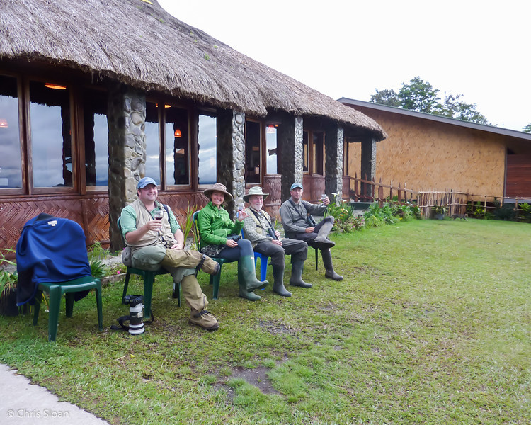Chris Sloan, Melinda Welton, John Noel, and Sam Woods drinking outside Ambua Lodge, Papua New Guinea (10-04-2013).jpg