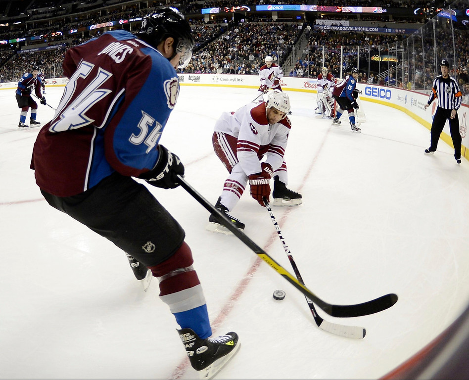 . DENVER, CO. - FEBRUARY 11: David Jones (54) of the Colorado Avalanche chases after the puck with Boyd Gordon (15) of the Phoenix Coyotes during the first period February 11, 2013 at Pepsi Center.(Photo By John Leyba/The Denver Post)