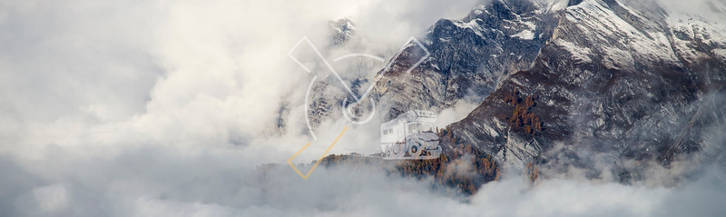 Aerial image of beautiful mountain landscape with clouds in the Valais Kanton