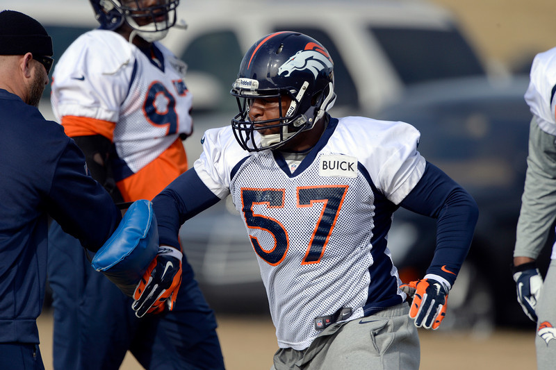 . Denver Broncos defensive end Jeremy Mincey (57)  runs through drills during practice January 16, 2014 at Dove Valley. The Denver Broncos are preparing for their AFC Championship game against the New England Patriots at Sports Authority Field.  (Photo by John Leyba/The Denver Post)