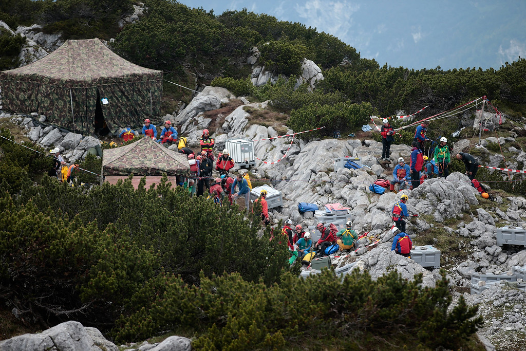 . Rescue workers stand at the entrance to the Riesending vertical cave after the final phase of the transport of injured spelunker Johann Westhauser to the surface on June 19, 2014 near Marktschellenberg, Germany.  (Photo by Johannes Simon/Getty Images)