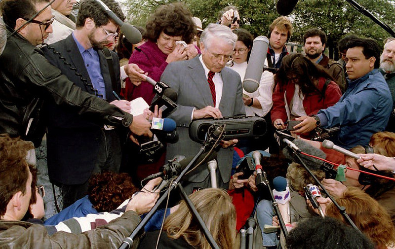 . Attorney James Brannan plays a tape for the media on March 18, 1993 as his client Jean Holub, grandmother of besieged cult leader David Koresh, wipes her eyes. The tape contained a message from Holub to Koresh, asking Koresh to surrender himself and more than 100 cult members involved in the 19-day standoff at the Branch Davidian compound BOB PEARSON/AFP/Getty Images