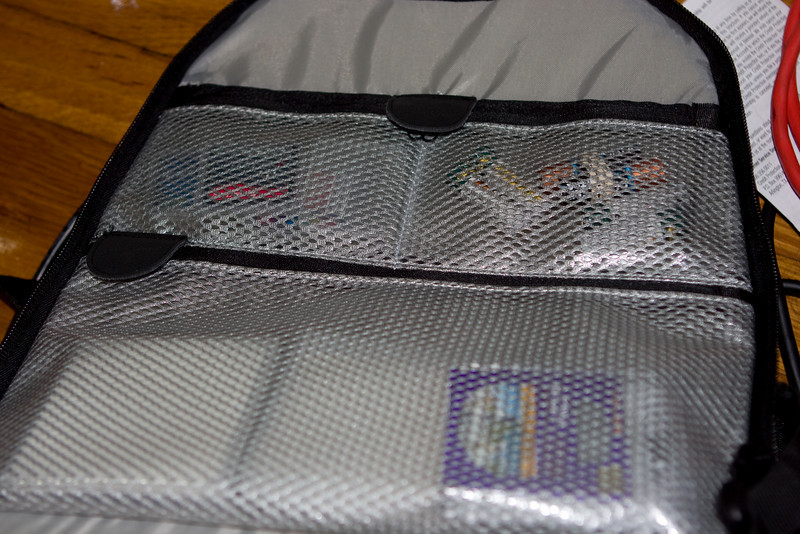 Pockets: filters on the bottom, CF cards top left, AA batteries top right.