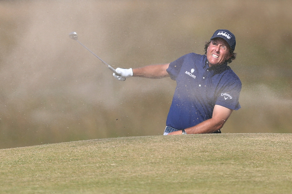 . Phil Mickelson of the United States plays out of a bunker on the 15th hole during the third round of the British Open Golf Championship at Muirfield, Scotland, Saturday July 20, 2013. (AP Photo/Scott Heppell)