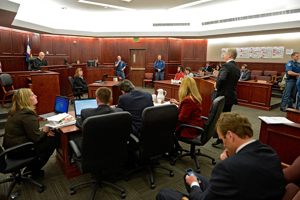 . District Attorney George Brauchler, standing at podium, addresses the court during the arraignment of James Holmes, Aurora theater shooting suspect, in Centennial, Colo., on Tuesday, March 12, 2013.  (AP Photo/Denver Post, RJ Sangosti, Pool)