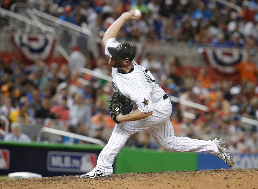 . National League\'s Colorado Rockies pitcher Greg Holland (56) delivers a pitch in the seventh inning, during the MLB baseball All-Star Game, Tuesday, July 11, 2017, in Miami. (AP Photo/Lynne Sladky)