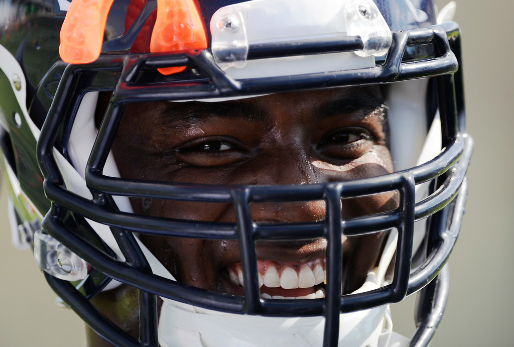 . Denver Broncos defensive end DeMarcus Ware (94) laughs during drills on the first day of the Denver Broncos 2014 training camp July 24, 2014 at Dove Valley. (Photo by John Leyba/The Denver Post)