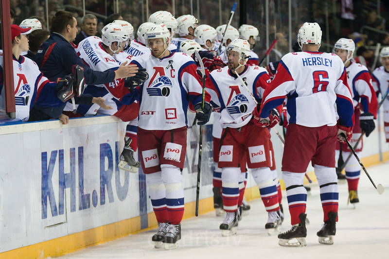 Players of Lokomotiv Yaroslavl celebrate the goal with captain Staffan Kronwall (27) in the front