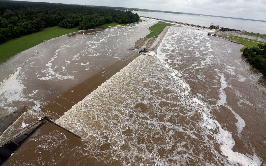 . Water flows over the spillway from Lake Houston into the San Jacinto River Saturday, May 30, 2015, in Houston. The Colorado River in Wharton and the Brazos and San Jacinto rivers near Houston are the main focus of concern as floodwaters moved from North and Central Texas downstream toward the Gulf of Mexico. (AP Photo/David J. Phillip)