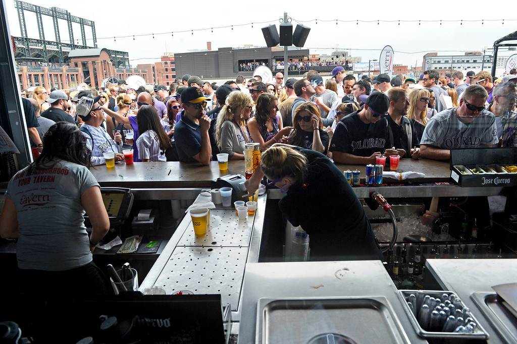. Fans gather on the roof of Tavern Downtown on Market Street before the start of the game. The Colorado Rockies took on the San Diego Padres on Opening Day at Coors Field in Denver, Colorado. (Photo by Andy Cross/The Denver Post)