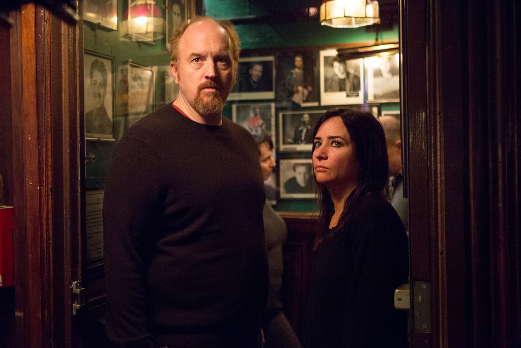""". In this image released by FX, Louis C.K., left, and Pamela Adlon appear in a scene from \""""Louie.\"""" He was nominated for a Golden Globe for best actor in a comedy series for his role on the show, on Thursday, Dec. 11, 2014. The 72nd annual Golden Globe awards will air on NBC on Sunday, Jan. 11. (AP Photo/FX, KC Bailey)"""
