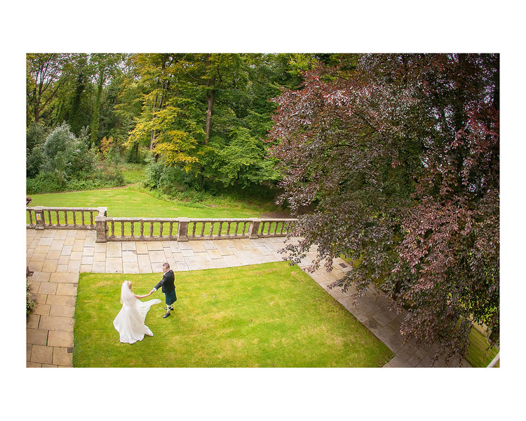 Wedding Photography of Linsey & Mark, Gean House, Alloa, Photograph is of the Bride & Groom dancing under a tree in the house grounds