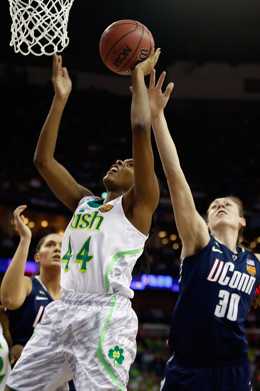 . Ariel Braker #44 of the Notre Dame Fighting Irish makes a shot over Breanna Stewart #30 of the Connecticut Huskiesduring the National Semifinal game of the 2013 NCAA Division I Women\'s Basketball Championship at the New Orleans Arena on April 7, 2013 in New Orleans, Louisiana.  (Photo by Chris Graythen/Getty Images)