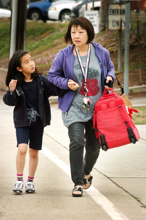 ". Stephanie Law, a second grade student leaving Brightwood School with her mother Sannie Lau after school cancelled its lockdown. A 19-year-old man was arrested for allegedly making phone calls to the California Highway Patrol threatening gun violence against local schools on Thursday, May 16, 2013. When the suspect called to make the threat, he said he was en route to a college in Monterey Park, she said. The call was made from a cell phone and was received from the East Los Angeles and Monterey Park areas, officials said.About 14 schools were locked down during the incident. At about 9:30 a.m., Santa Monica Community College police arrested a suspect, a 19-year old male in connection with this threat as well as the Santa Monica threat,"" Los Angeles County Sheriff\'s spokeswoman  The suspect was arrested on the Santa Monica campus and it was unclear if he had any weapons.(SGVN/Photo by Walt Mancini)"