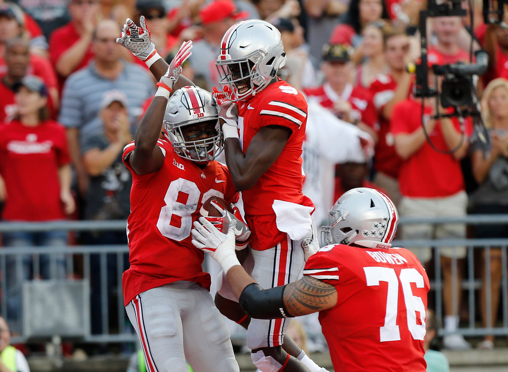 . Ohio State players Terry McLaurin, left to right, Victor Binjimen, and Branden Bowen celebrate a touchdown against Army during the second half of an NCAA college football game Saturday, Sept. 16, 2017, in Columbus, Ohio. Ohio State beat Army 38-7. (AP Photo/Jay LaPrete)