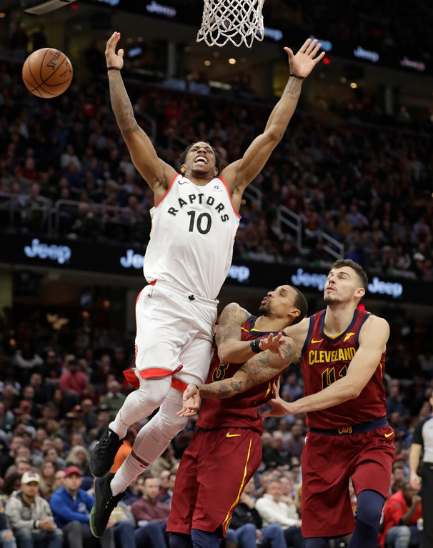 . Toronto Raptors\' DeMar DeRozan, left to right, loses control of the ball against Cleveland Cavaliers\' George Hill and Cleveland Cavaliers\' Ante Zizic, from Croatia, in the first half of an NBA basketball game, Wednesday, March 21, 2018, in Cleveland. (AP Photo/Tony Dejak)