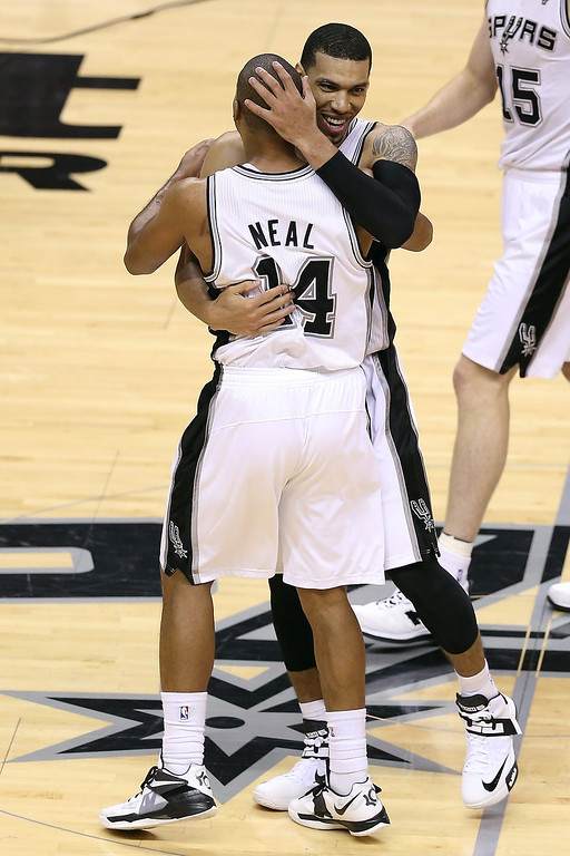 . Danny Green #4 hugs Gary Neal #14 of the San Antonio Spurs in the second quarter while taking on the Miami Heat during Game Three of the 2013 NBA Finals at the AT&T Center on June 11, 2013 in San Antonio, Texas.   (Photo by Christian Petersen/Getty Images)