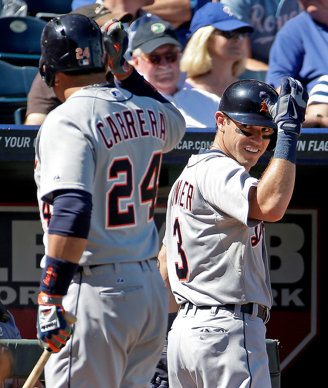 . Detroit Tigers\' Ian Kinsler (3) celebrates with Miguel Cabrera (24) after Kinsler hit a solo home run during the third inning of a baseball game against the Kansas City Royals Sunday, Sept. 21, 2014, in Kansas City, Mo. (AP Photo/Charlie Riedel)