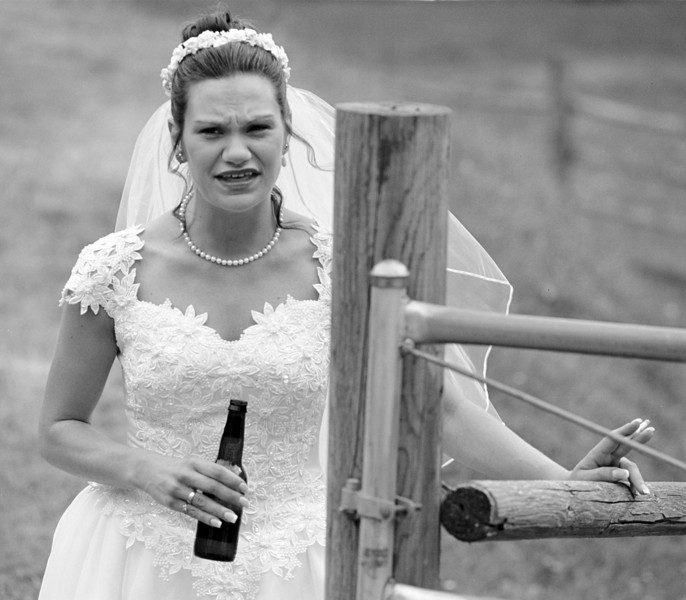 The bride takes a moment alone before the service begins.