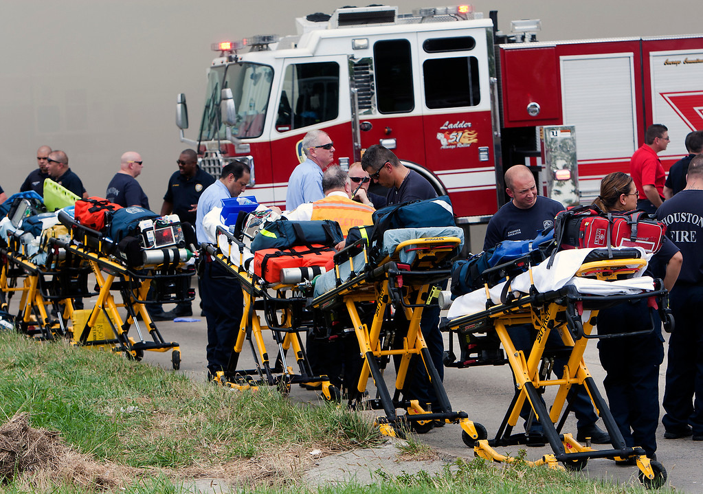 . Medics line up in preparation for patients during a blaze at the Southwest Inn on U.S. 59 in Houston on Friday, May 31, 2013. (AP Photo/Houston Chronicle, Cody Duty)