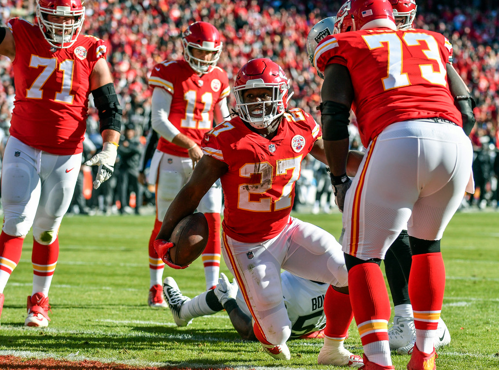 . Kansas City Chiefs running back Kareem Hunt (27) gets up after scoring on a one-yard run during the first half of an NFL football game against the Oakland Raiders in Kansas City, Mo., Sunday, Dec. 10, 2017. (AP Photo/Ed Zurga)