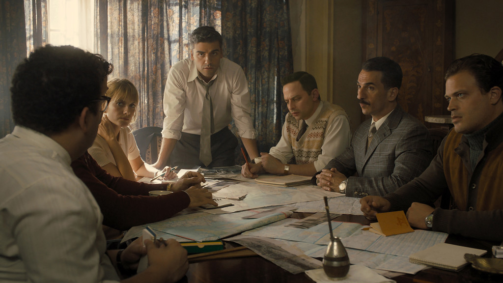 . Mélanie Laurent, left, Oscar Isaac, Nick Kroll, Michael Aronov and Greg Hill portray members of a Israeli intelligence team charged with bringing a Nazi war criminal from Argentino to Israel to stand trial. The movie opened in theaters Aug. 29. (Metro Goldwyn Mayer Pictures)