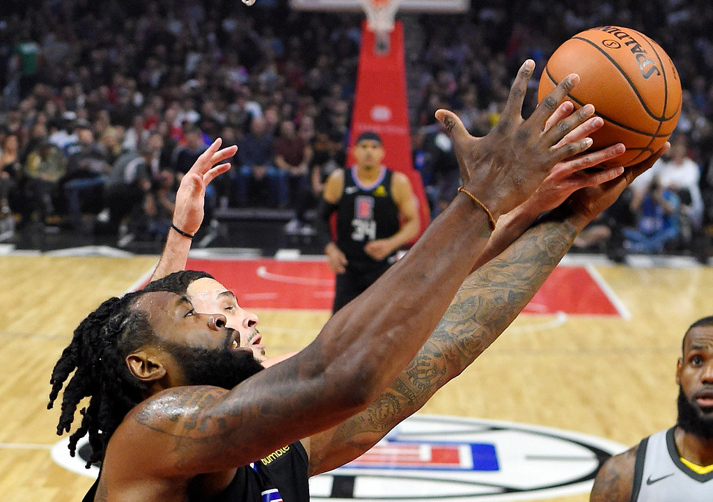 . Los Angeles Clippers center DeAndre Jordan, front and Cleveland Cavaliers forward Larry Nance Jr. reach for a rebound during the first half of an NBA basketball game, Friday, March 9, 2018, in Los Angeles. (AP Photo/Mark J. Terrill)