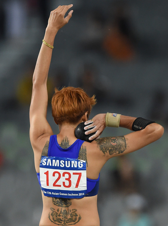 . Thailand\'s Wassana Winatho competes in the women\'s heptathlon shot put athletics event during the 17th Asian Games at the Incheon Asiad Main Stadium in Incheon on September 28, 2014.  PHILIPPE LOPEZ/AFP/Getty Images