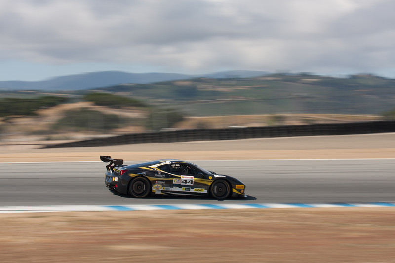 John Taylor races towards turn 11 in the #44 Ferrari 458 EVO. © 2014 Victor Varela
