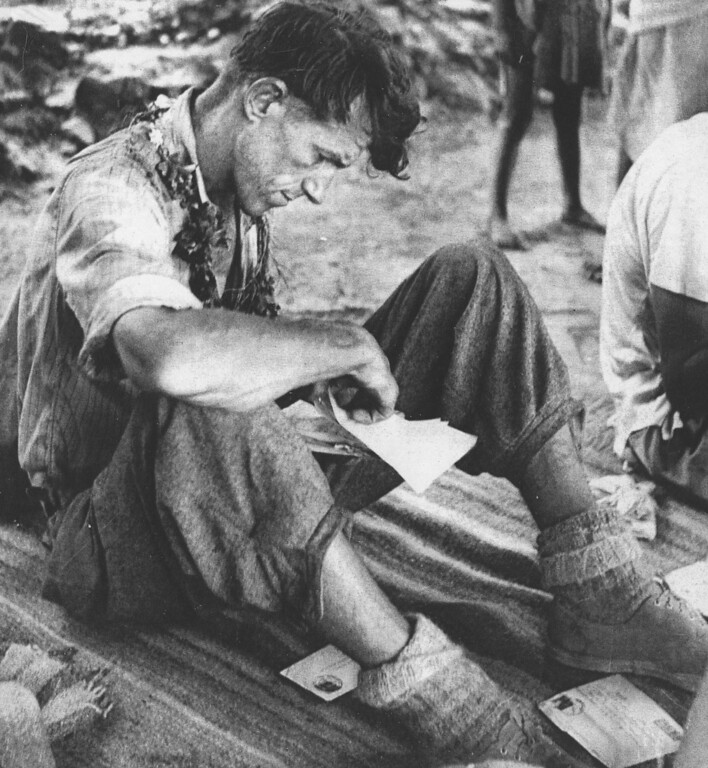 . On May 29, 1953, Sir Edmund Hillary of New Zealand became the first person to reach the top of Mount Everest. Here he catches up on some mail after coming down from the summit of the world\'s highest mountain. Denver Post Archive Photo