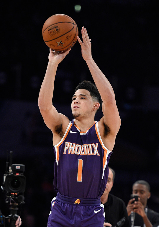. Phoenix Suns\' Devin Booker shoots during the NBA All-Star basketball Three Point contest, Saturday, Feb. 17, 2018, in Los Angeles. (AP Photo/Chris Pizzello)