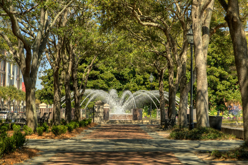 Large trees cover the paths leading to the popular water fountain in Waterfront Park in downtown Charleston, SC on Saturday, March 9, 2013. Copyright 2013 Jason Barnette