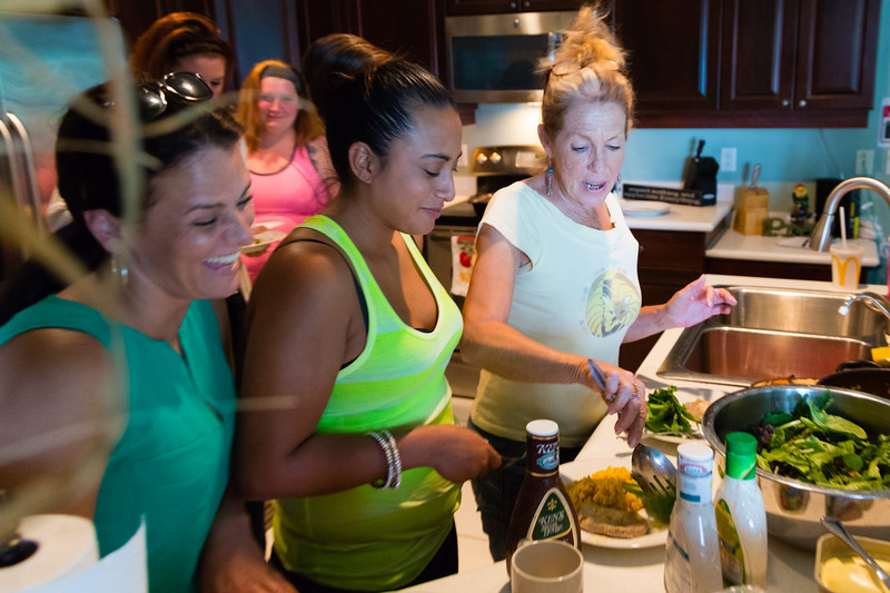 Sober home residents Amy Kilgore (left), Mariana Lovecchio and 'house mom' Karen Altieri Sharp fill their plates with food prepared by Sparrow at the All About Recovery younger women's sober home in Loxahatchee, Florida on Wednesday, June 1, 2016. (Joseph Forzano / The Palm Beach Post)