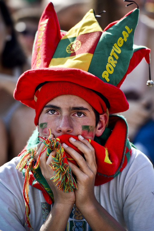 . A fan of the Portugal national football team watches in Eduardo VII Park in Lisbon on June 16, 2014  the FIFA World Cup 2014 match Germany vs Portugal played in Salvador, Brazil. AFP PHOTO/ PATRICIA DE MELO  MOREIRA/AFP/Getty Images