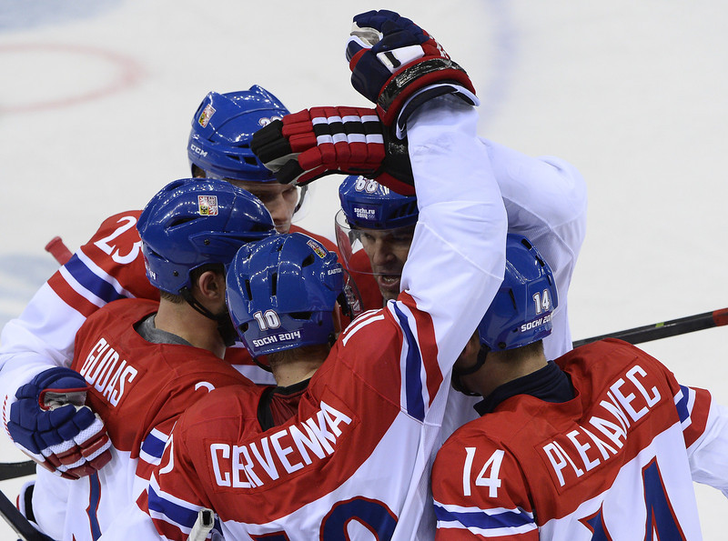 . Czech Republic\'s Roman Cervenka (C) celebrates after scoring during the Men\'s Ice Hockey Play-offs Czech Republic vs Slovakia at the Shayba Arena during the Sochi Winter Olympics on February 18, 2014. (JONATHAN NACKSTRAND/AFP/Getty Images)