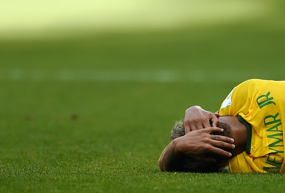 . Brazil\'s forward Neymar reacts after falling during the round of 16 football match between Brazil and Chile at The Mineirao Stadium in Belo Horizonte during the 2014 FIFA World Cup on June 28, 2014. (VANDERLEI ALMEIDA/AFP/Getty Images)