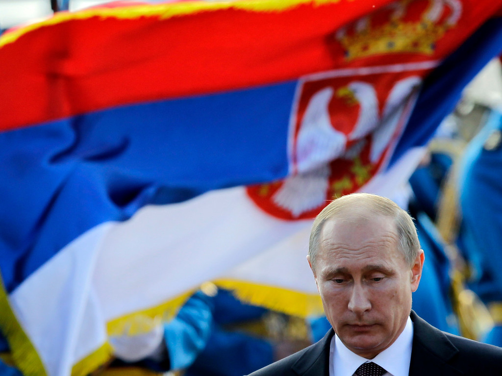 . Russian President Vladimir Putin reviews a guard of honor during a welcoming ceremony in Belgrade, Serbia, Thursday, Oct. 16, 2014. (AP Photo/Darko Vojinovic)
